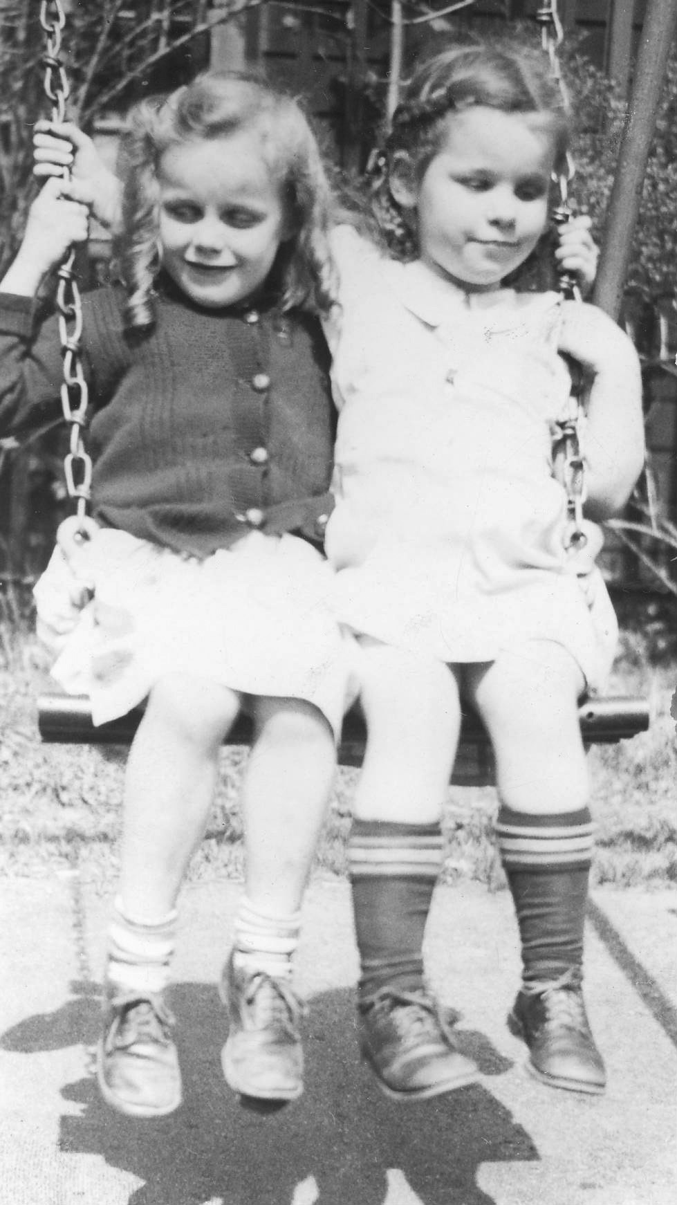 young girls on swing