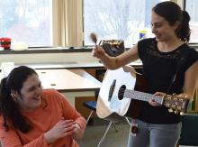 Music teacher entertains student
